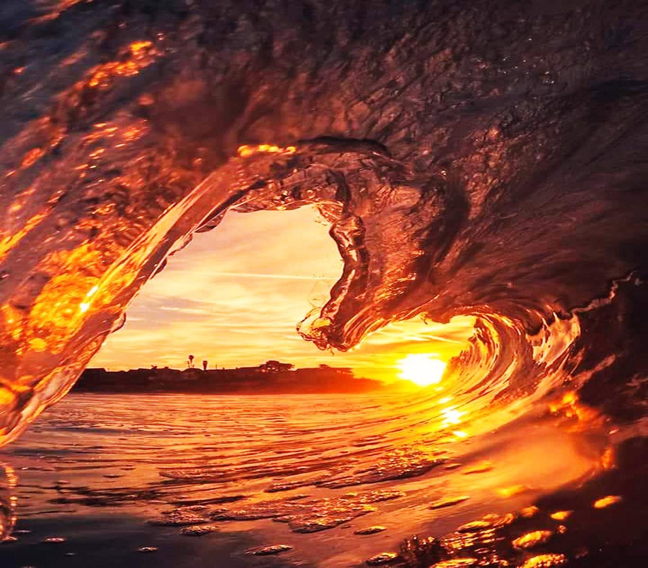 frozen wave against sunlight in the shape of a heart