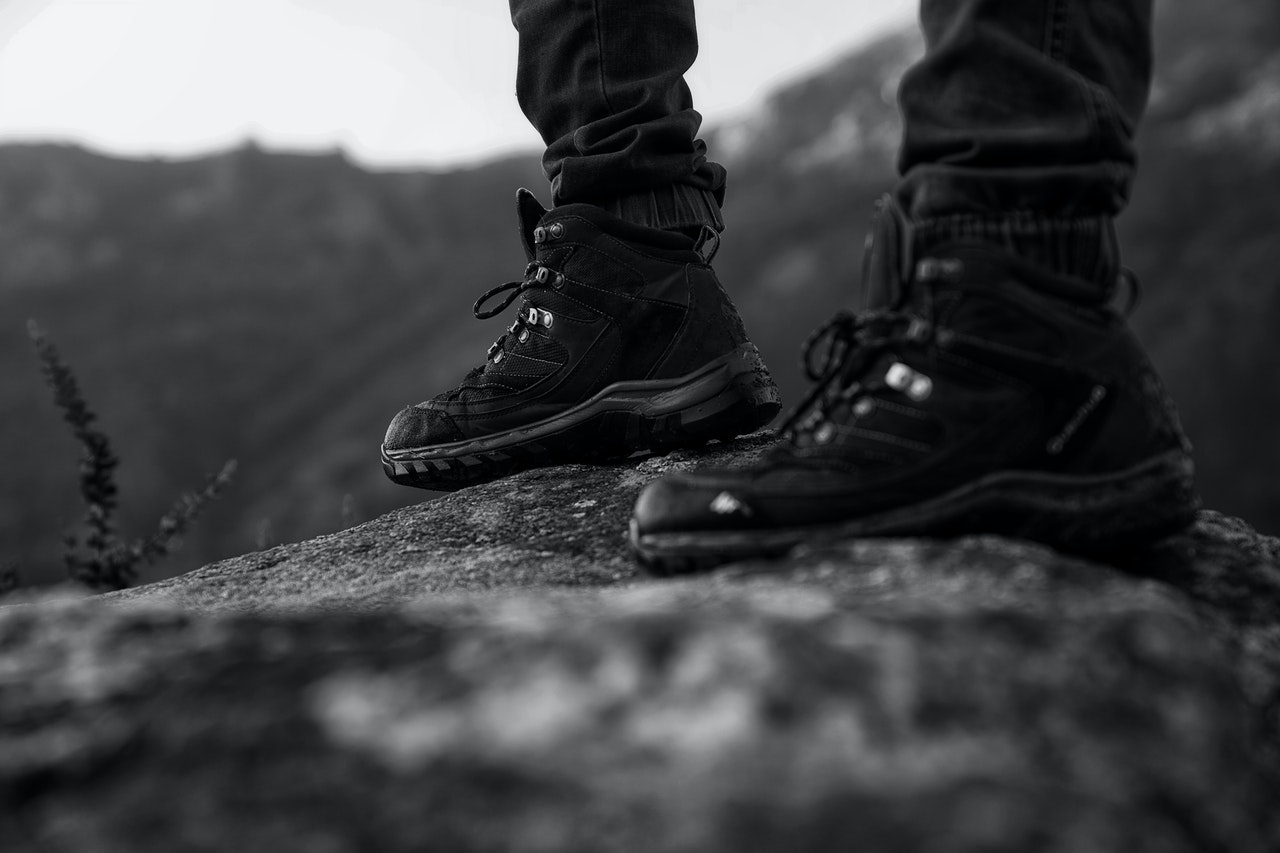 person wearing black boots standing firm